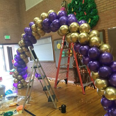 purple gold balloon arch