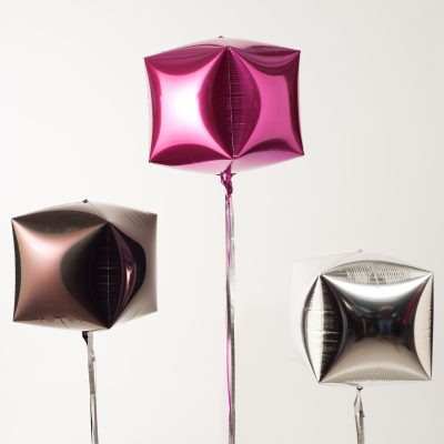 three Mylar balloons