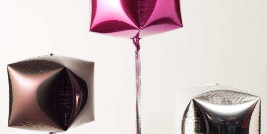 three Mylar balloons