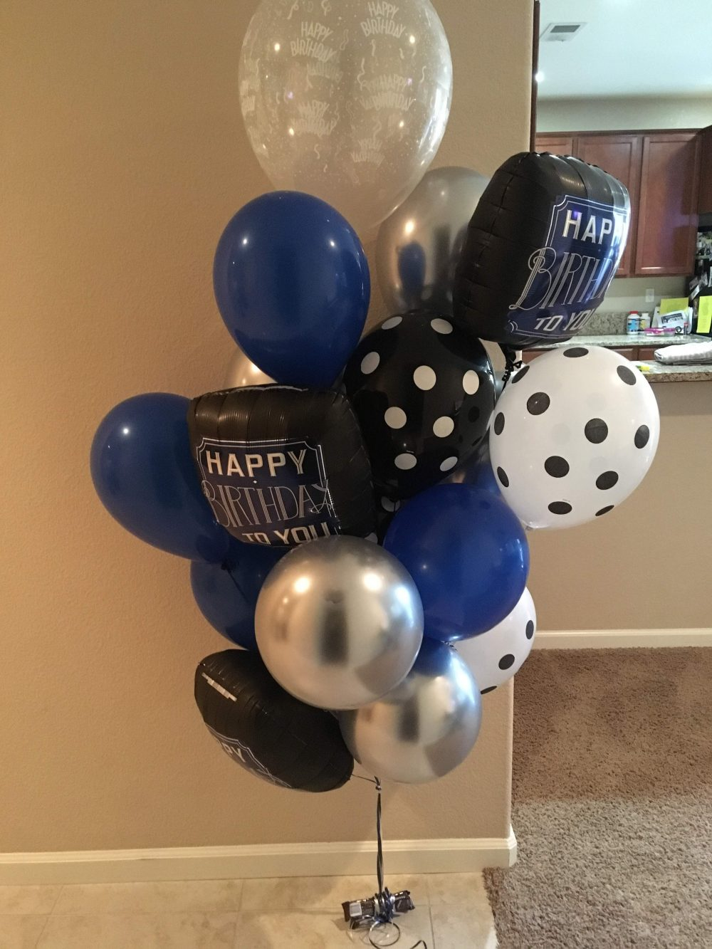 blue black balloon bouquets